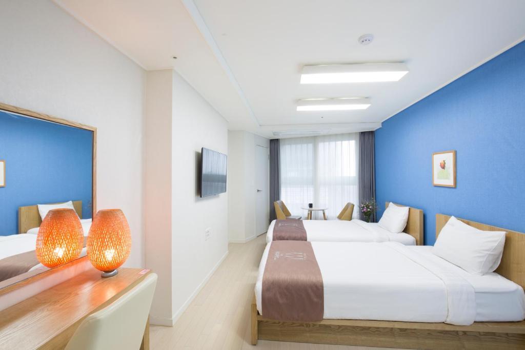 호텔 더 마크 해운대 객실 침대