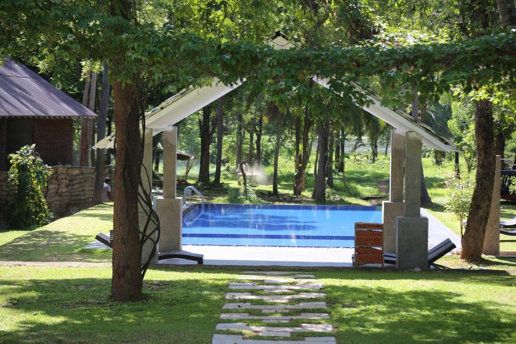 The swimming pool at or near Athena Lake