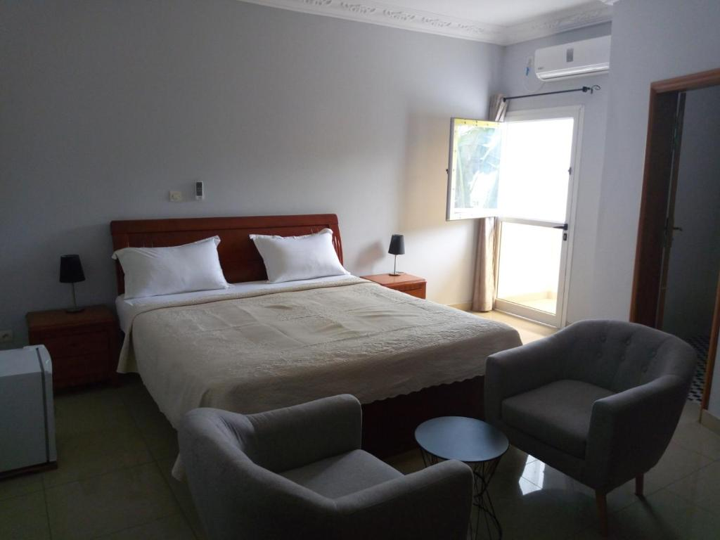 A bed or beds in a room at Edenia Hotel