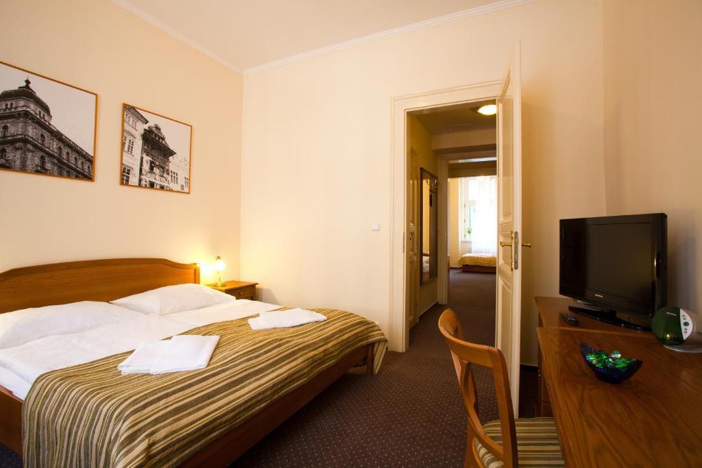 Cama o camas de una habitación en Anna Hotel