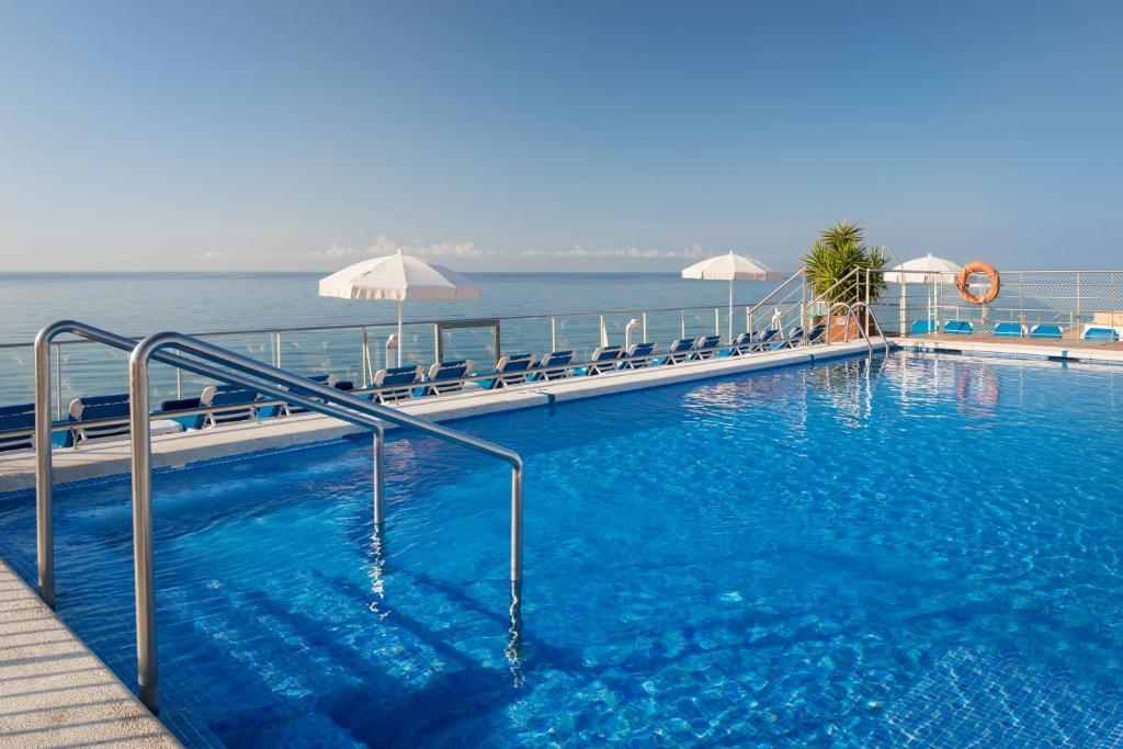 The swimming pool at or near htop Pineda Palace & SPA 4*Sup