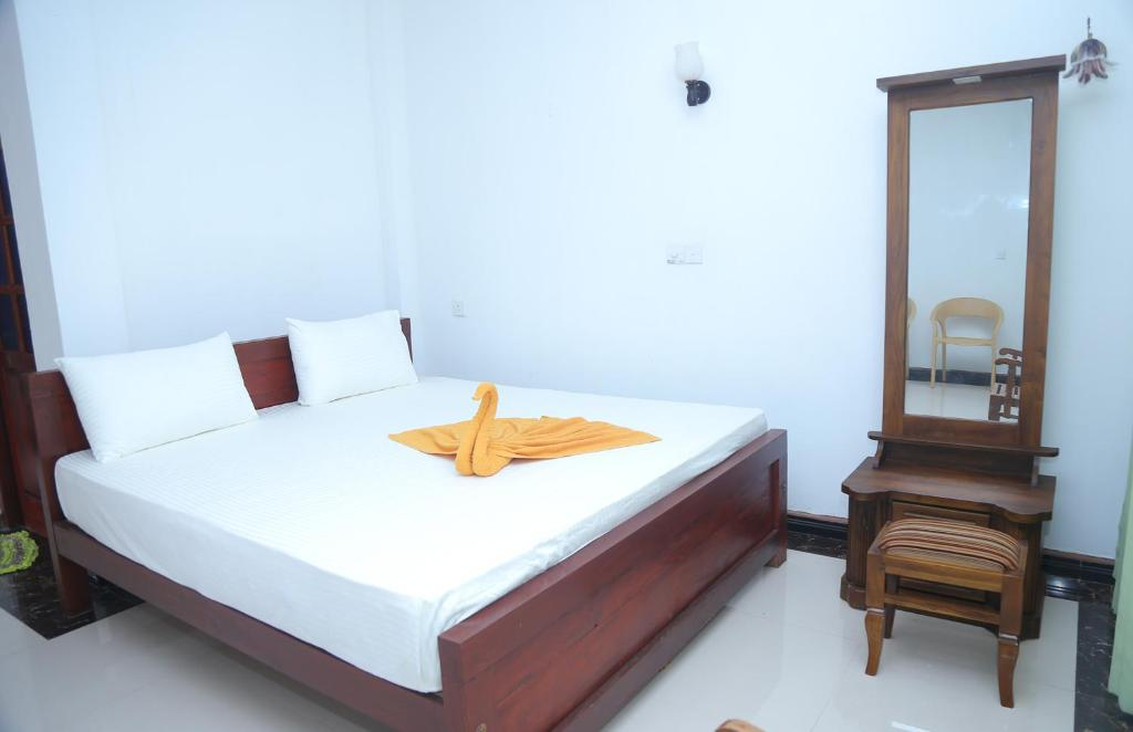 A bed or beds in a room at Villa Sidu