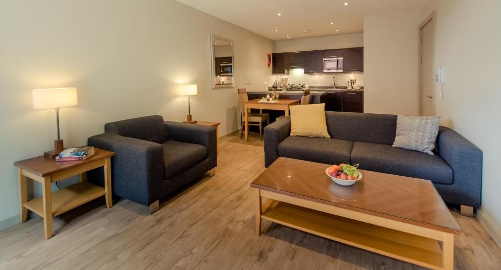 A seating area at PREMIER SUITES Manchester