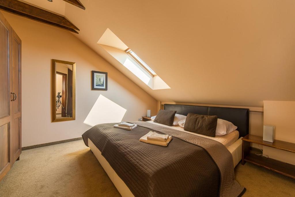 Posteľ alebo postele v izbe v ubytovaní Penzion Villa Regia
