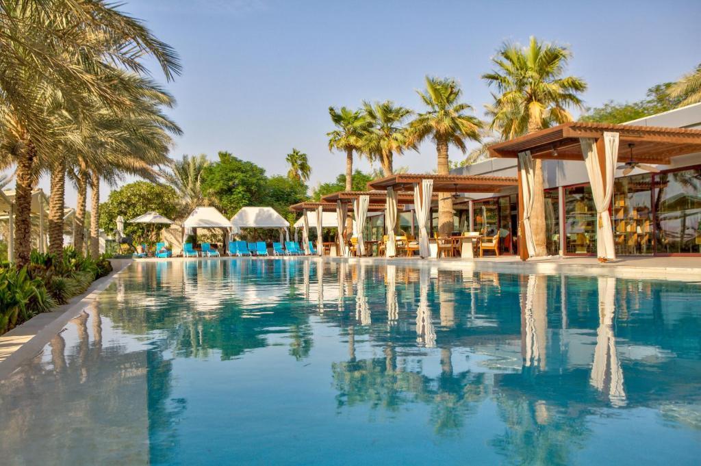 The swimming pool at or near Meliá Desert Palm Dubai