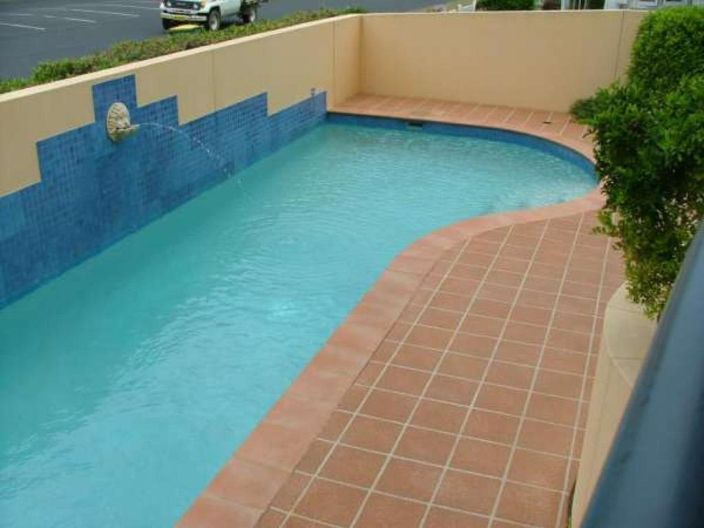 The swimming pool at or near Millenium, Unit 101, Cnr Head & West Sts