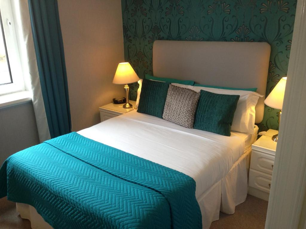 A bed or beds in a room at Lairg Highland Hotel