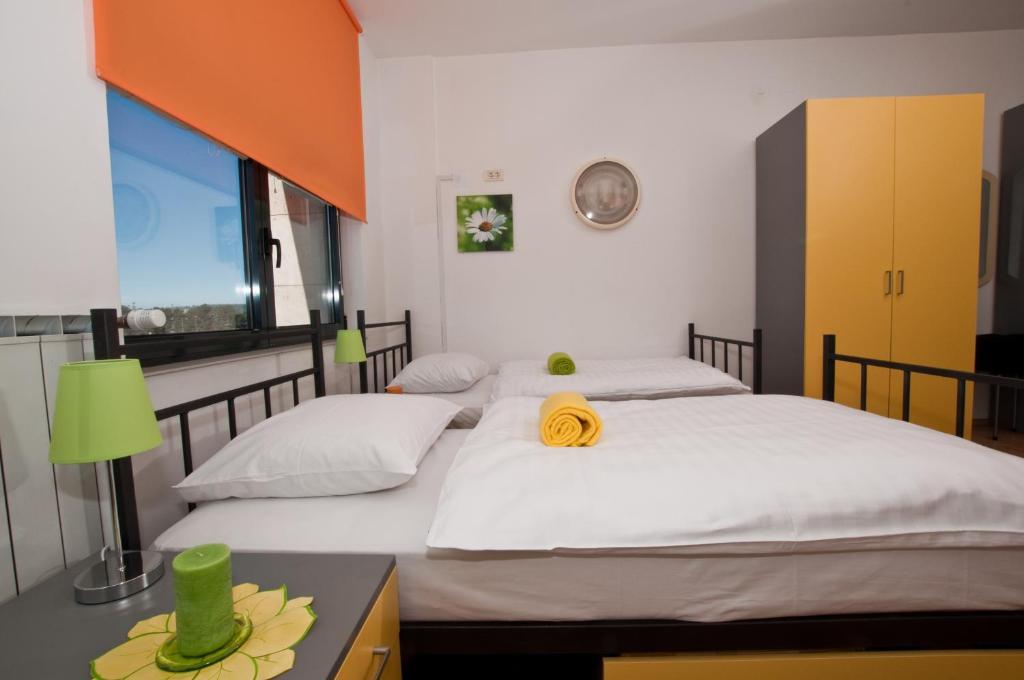 Un ou plusieurs lits dans un hébergement de l'établissement Motel Port