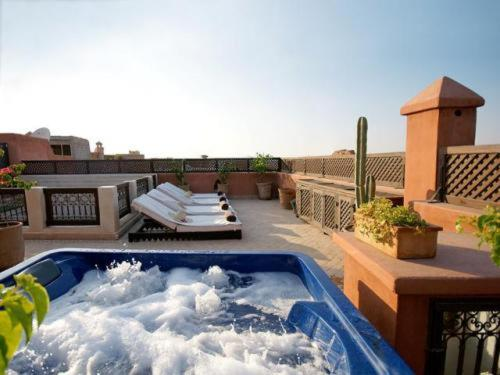 The swimming pool at or near Riad Dar Selen