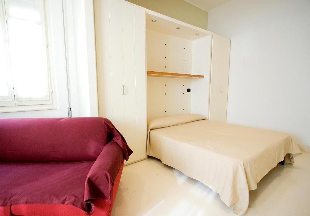 A bed or beds in a room at Residence Arco Antico