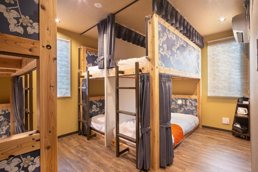 A bunk bed or bunk beds in a room at IKIDANE Cozy Hotel Haneda Airport
