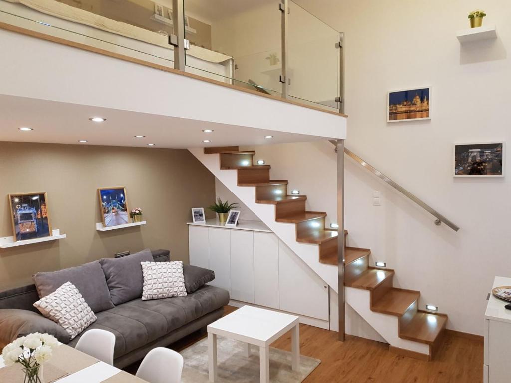 A seating area at Renaissance Studio Apartment