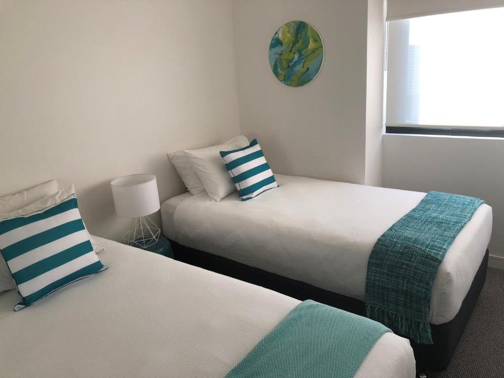 A bed or beds in a room at The William Apartments Jesmond