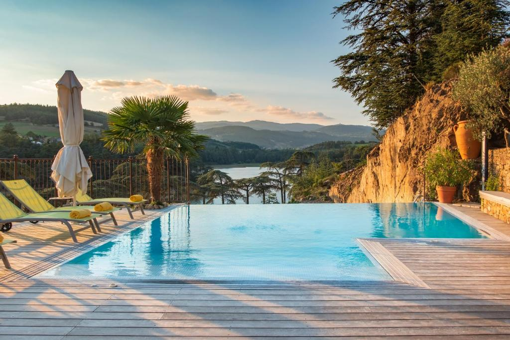 The swimming pool at or near Auberge Du Lac