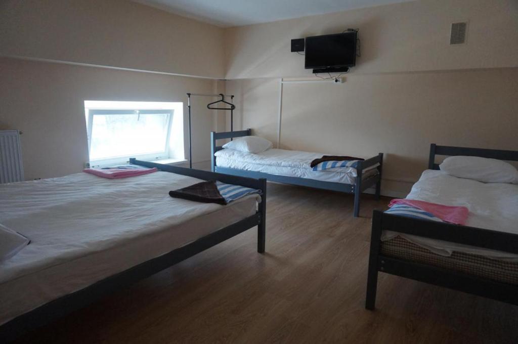 Кровать или кровати в номере Hostel Silver Owl