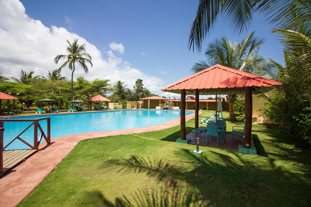 The swimming pool at or near Hotel Praia