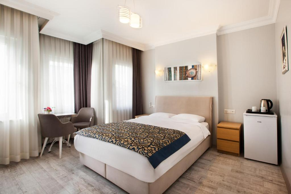 A bed or beds in a room at Sultanahmet Inn Hotel