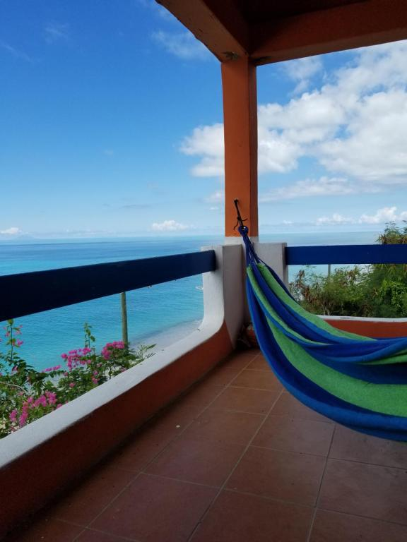 A balcony or terrace at Orrie's Beach Bar and Hotel