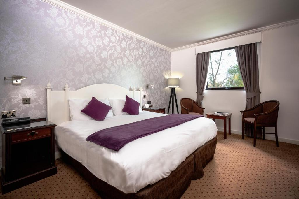 A bed or beds in a room at Best Western Burnley North Oaks Hotel and Leisure Club