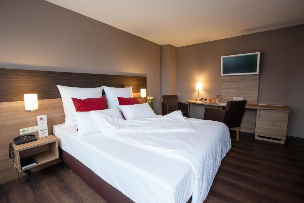 Ein Bett oder Betten in einem Zimmer der Unterkunft Centro Hotel U-NO 1