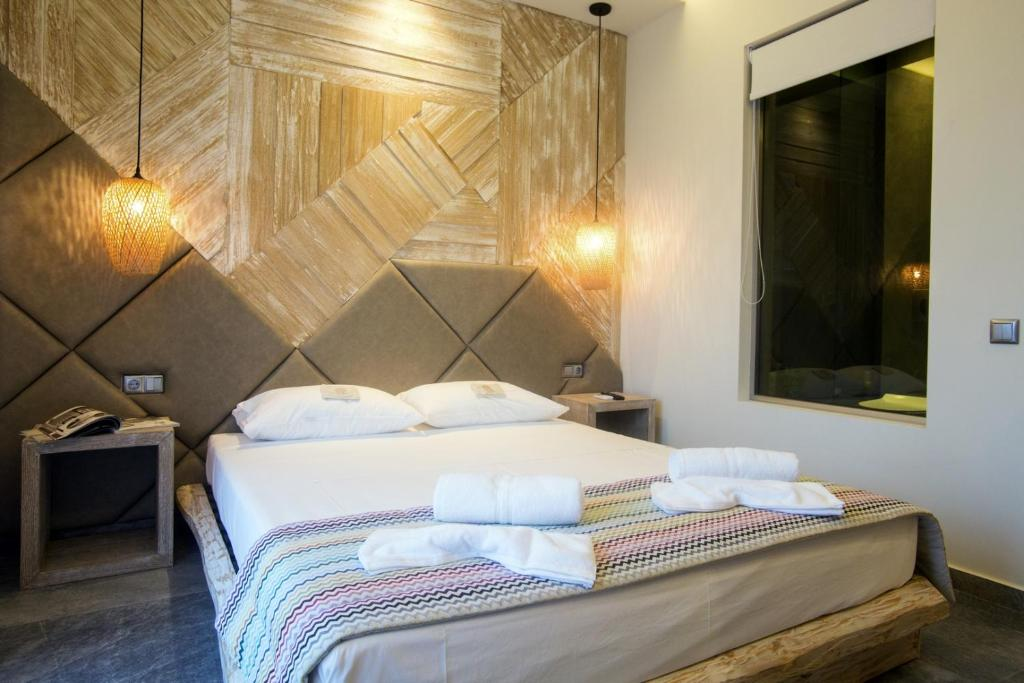 A bed or beds in a room at Katrine Boutique Apartments