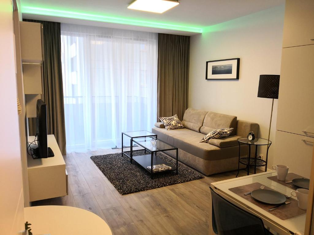 A seating area at Hestia Apartments Chopin Airport Deluxe