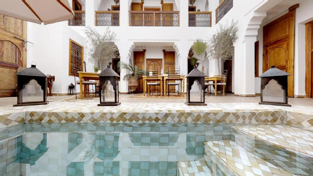 The swimming pool at or near Riad R.K