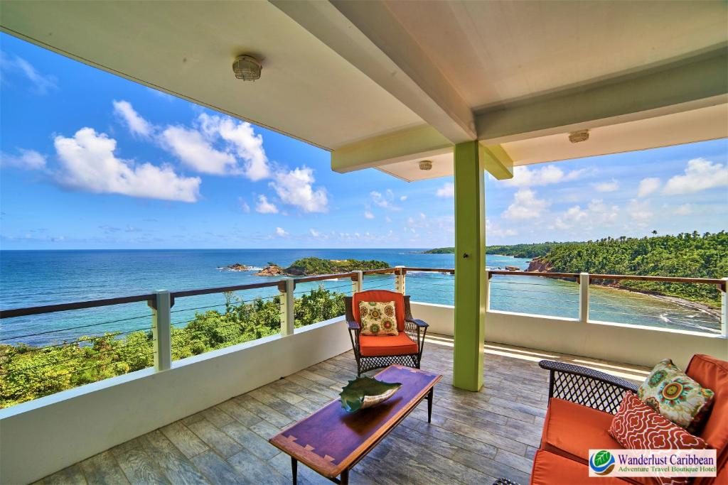 A balcony or terrace at Cloud9 Dominica Boutique Hotel