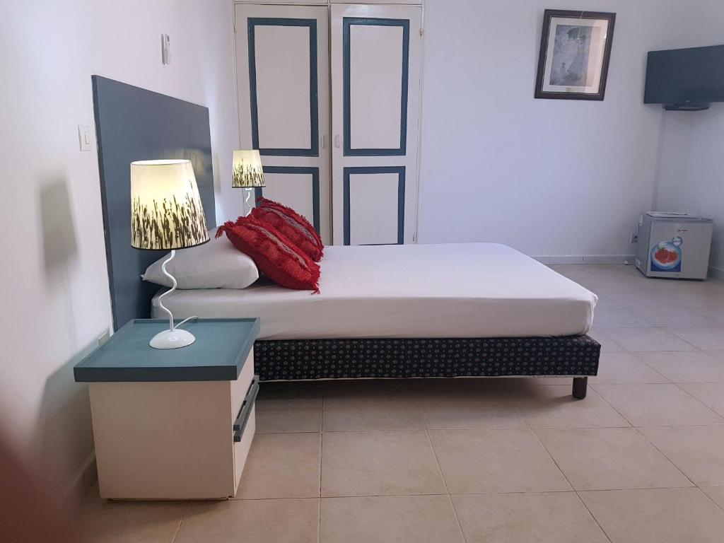 A bed or beds in a room at Chez Fatima et Hervé
