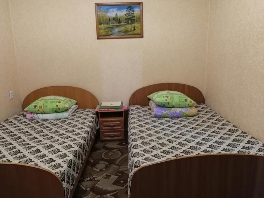 Кровать или кровати в номере Апартаменты на Ленинградской 25