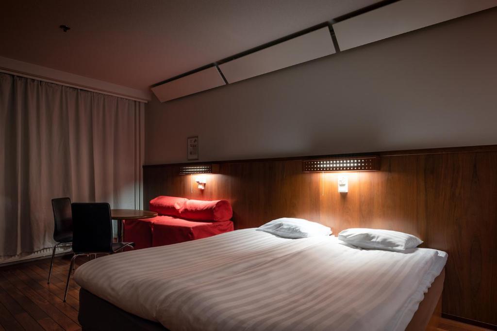 Vuode tai vuoteita majoituspaikassa Omena Hotel Jyväskylä