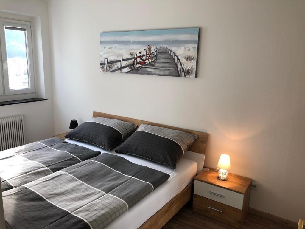 Ein Bett oder Betten in einem Zimmer der Unterkunft Apartment 4