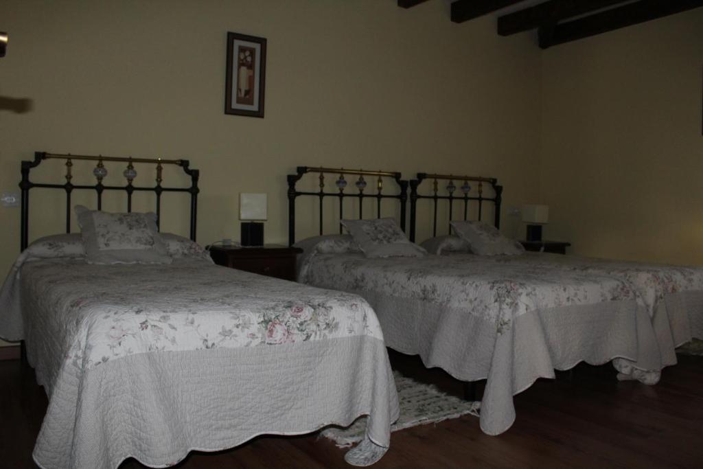 Cama o camas de una habitación en Apartamentos Sierra Guardatillo