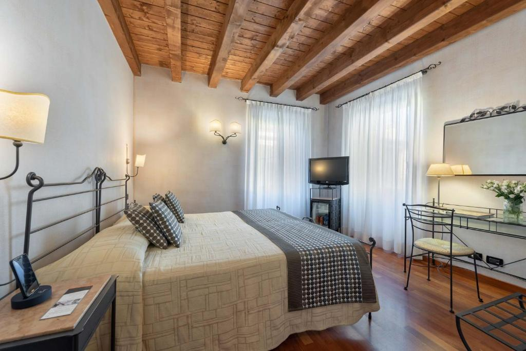 Letto o letti in una camera di Hotel Marco Polo