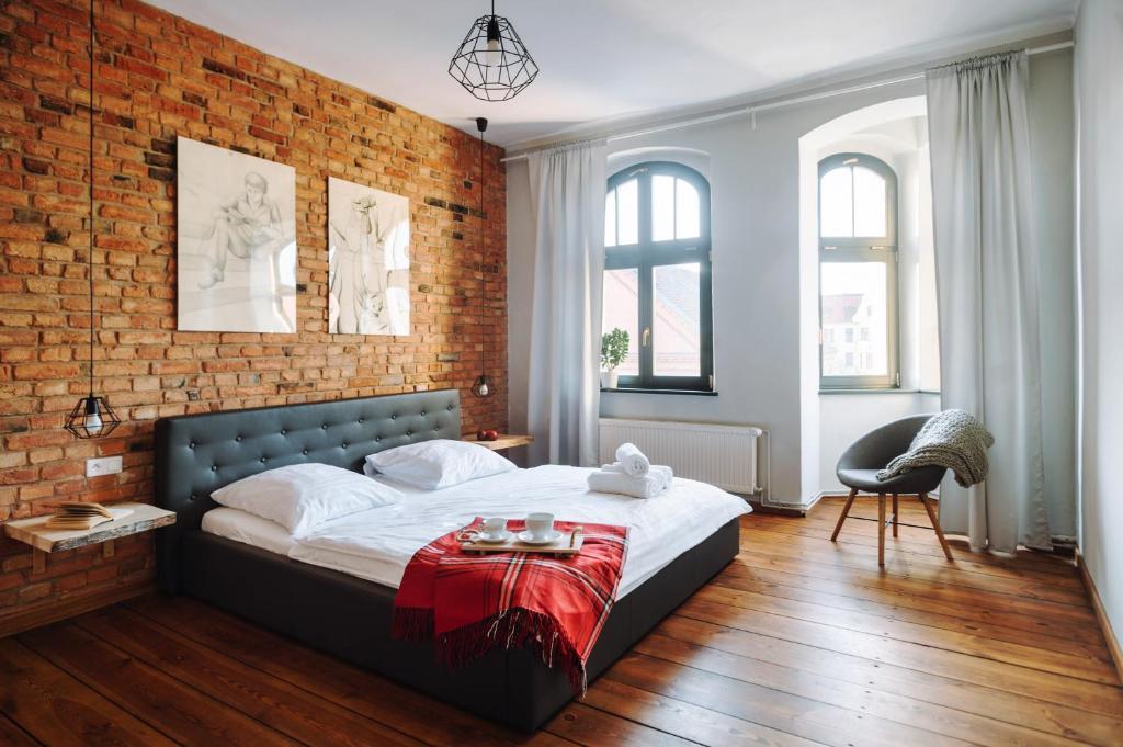 Łóżko lub łóżka w pokoju w obiekcie Apartamenty Europa