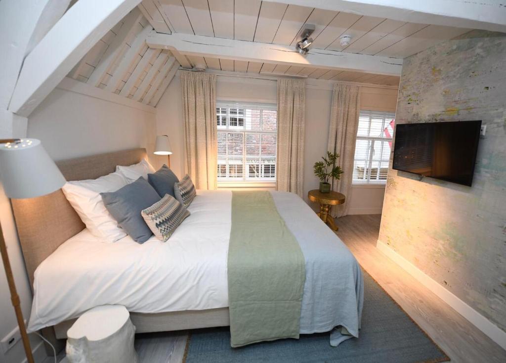 Un ou plusieurs lits dans un hébergement de l'établissement Hotel 't Fnidsen