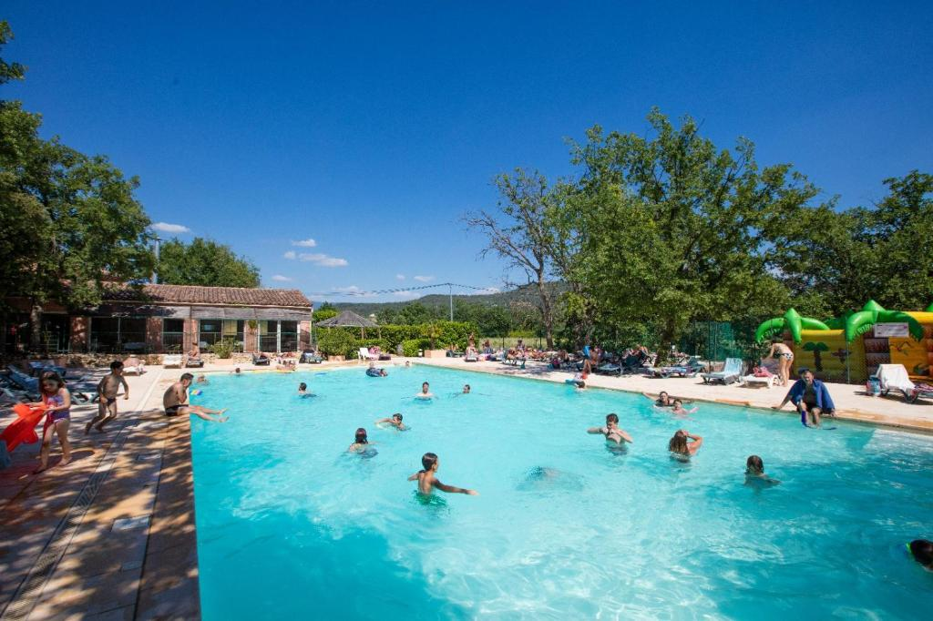 The swimming pool at or near Domaine Les Chênes Blancs