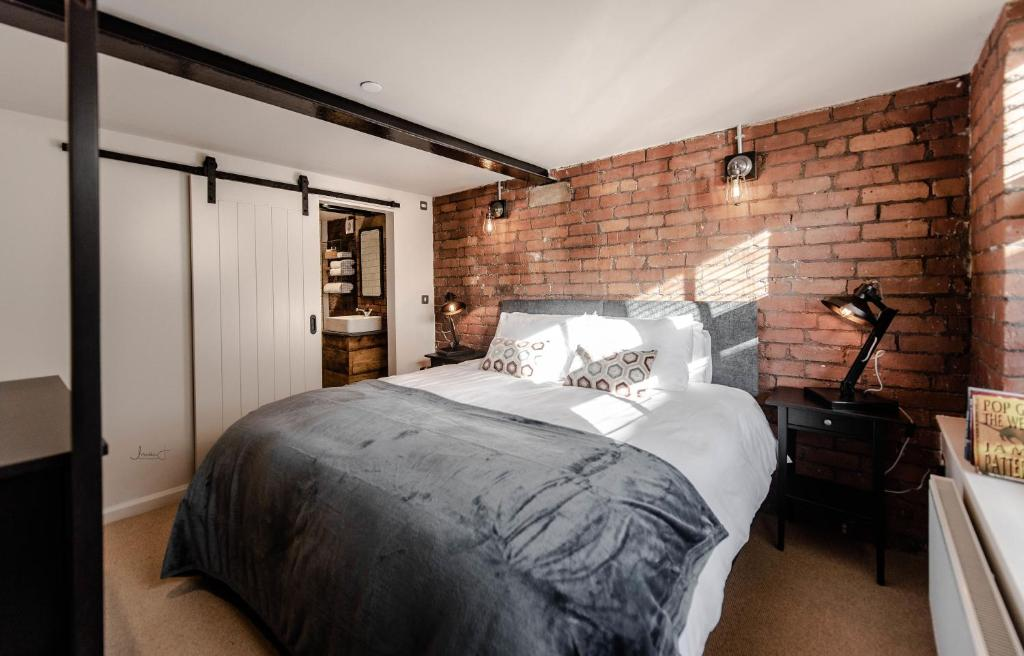 A bed or beds in a room at Home At The Mill Call to Book