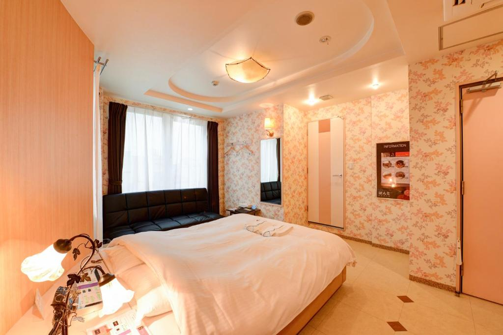 A bed or beds in a room at Hotel Ponto