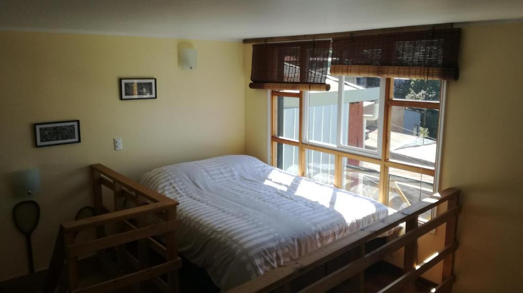 Cama o camas de una habitación en Loft Hostal JaguiHaus Sonne