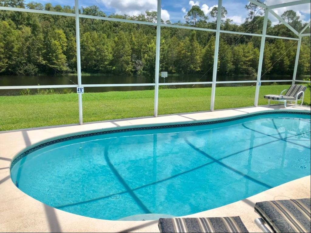 The swimming pool at or close to Creekside Villa by Exclusive Holiday Villas
