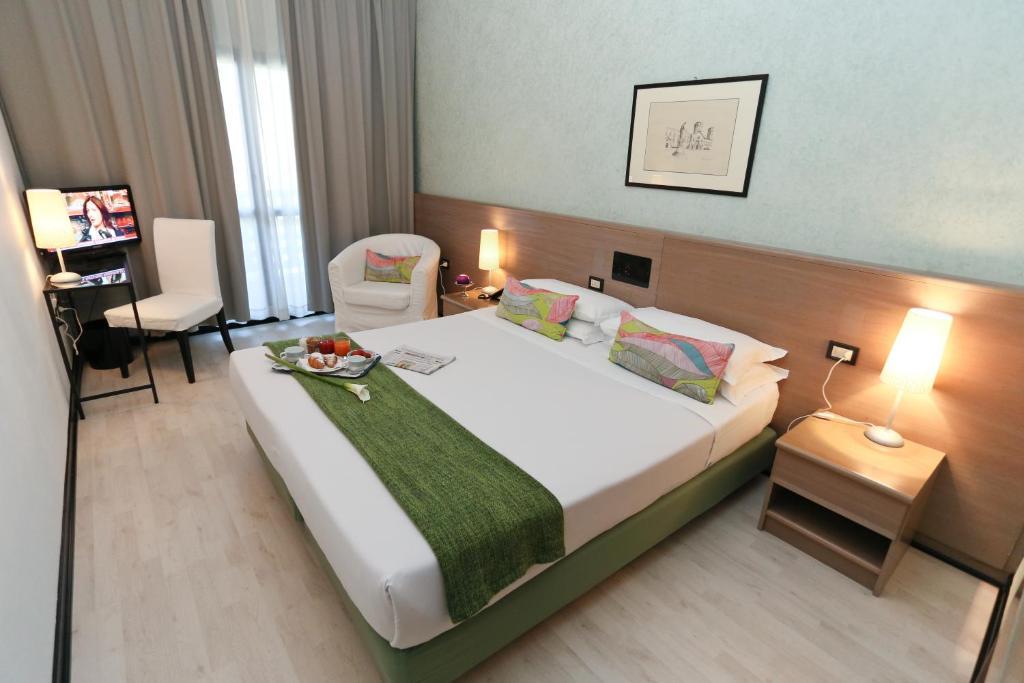 Letto o letti in una camera di Hotel Forum