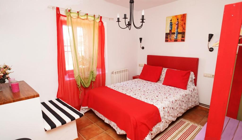 A bed or beds in a room at Casa Gatos