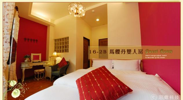 A bed or beds in a room at Hsitou Man Tuo Xiang Homestay