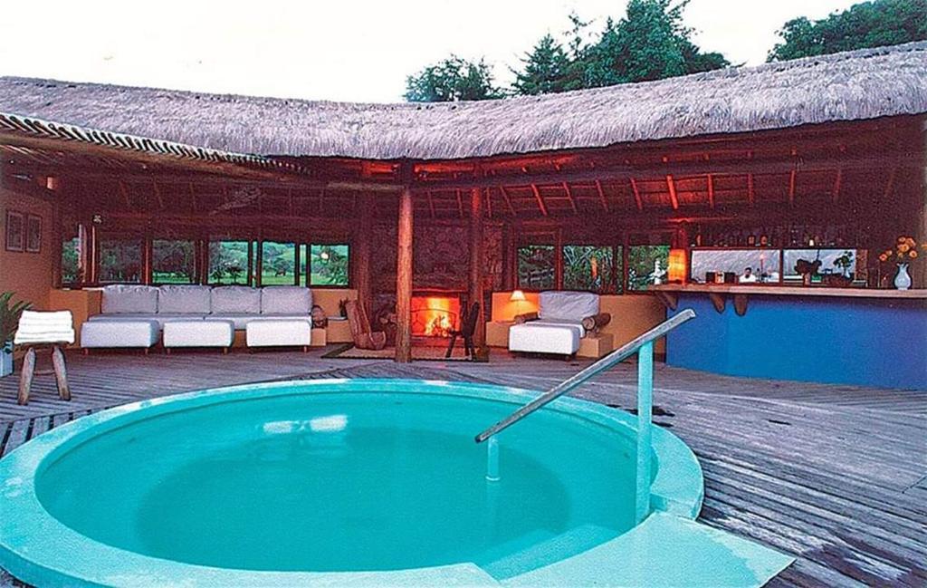 The swimming pool at or close to Hotel Fazenda Pedra Selada