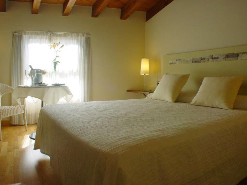 Cama o camas de una habitación en El Mirador de las Monjas