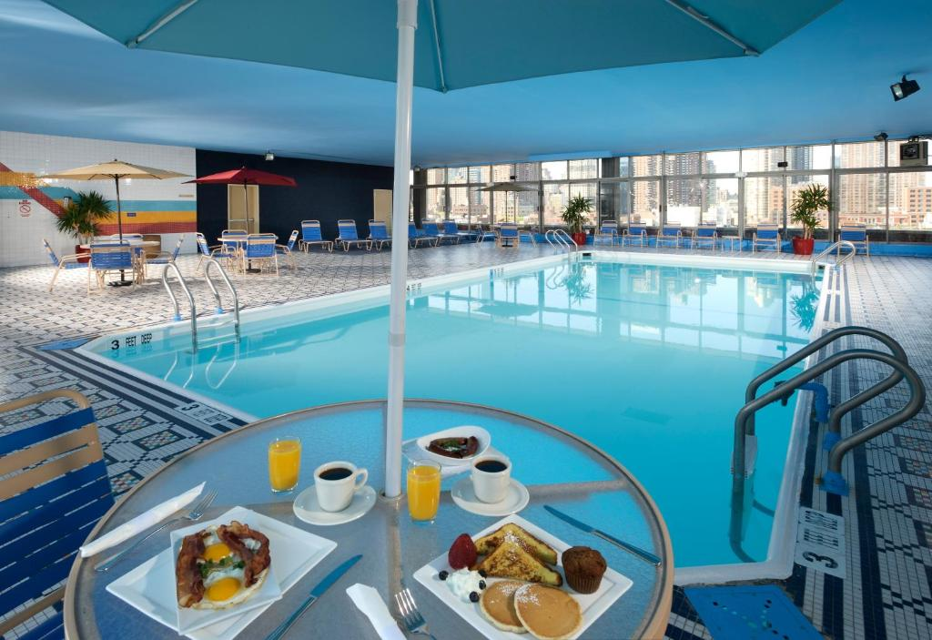 The swimming pool at or near The Skyline Hotel New York
