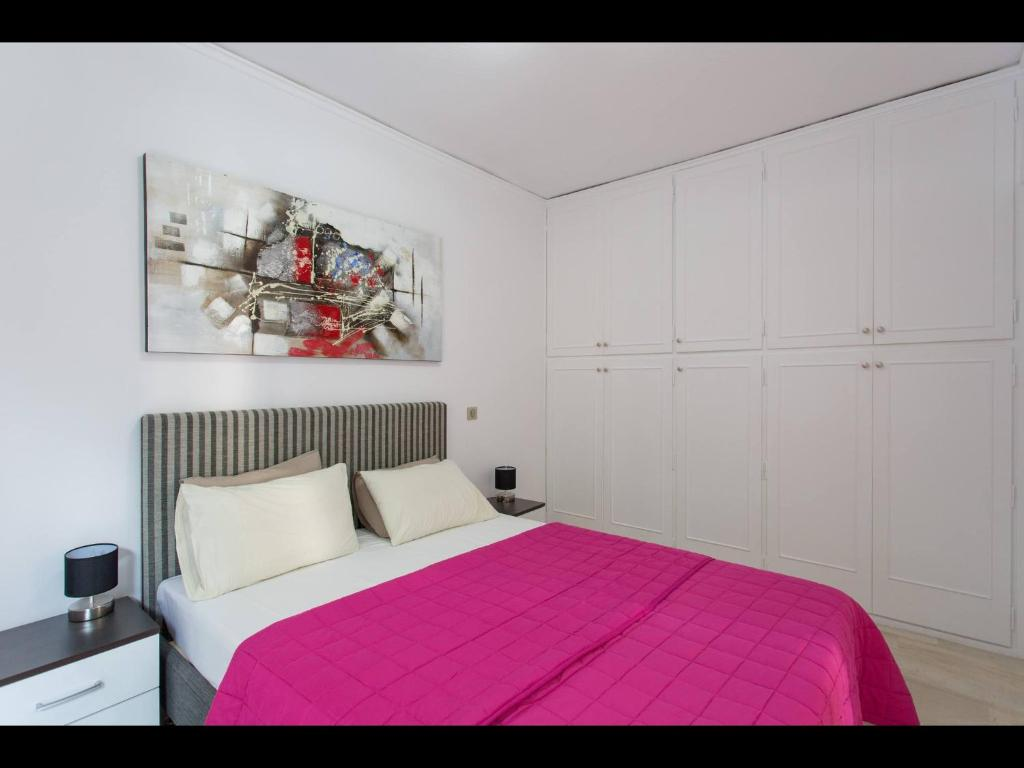 A bed or beds in a room at Acropolis Athens Amazing New Flat