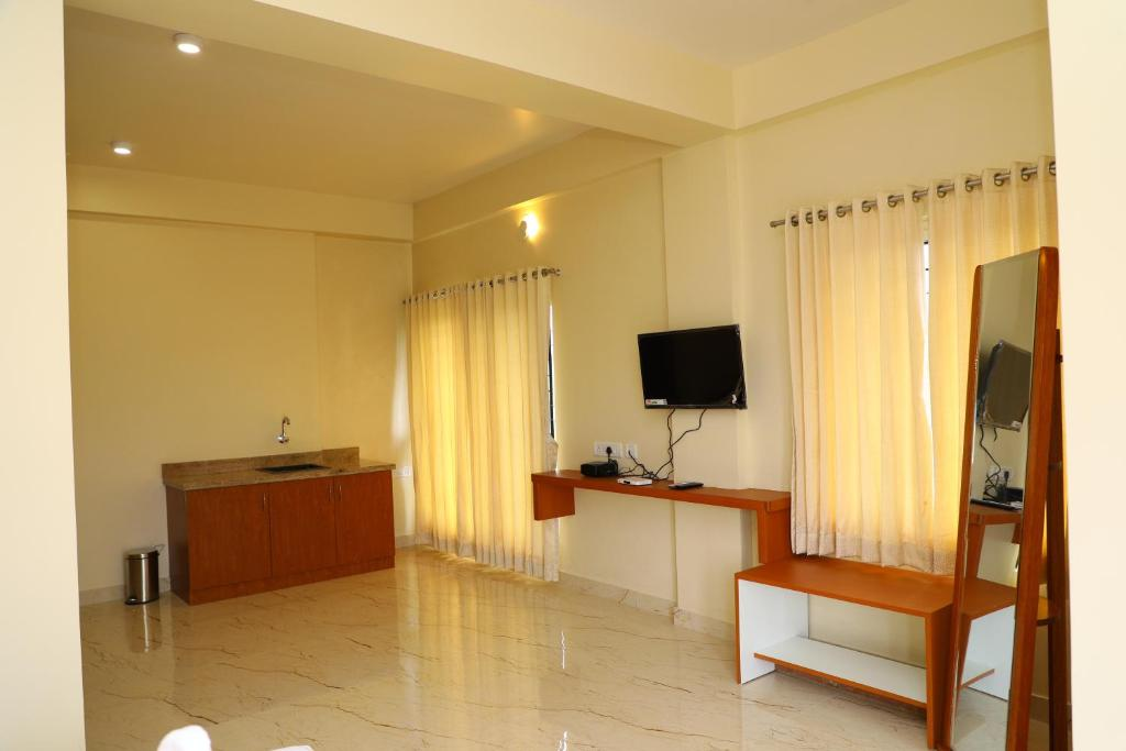 A television and/or entertainment centre at Lali Petals