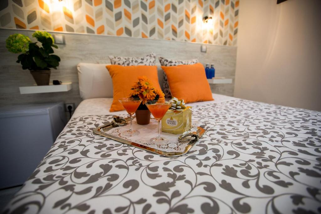 A bed or beds in a room at Bloom Inn Madrid